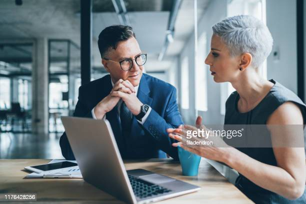 business coworkers - talking stock pictures, royalty-free photos & images