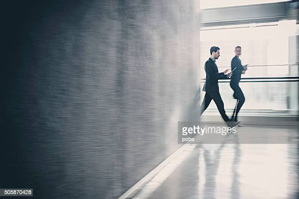 Business coworkers  walking together in office building