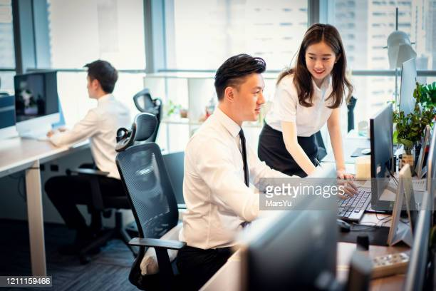 business coworkers working together at office - employee engagement stock pictures, royalty-free photos & images