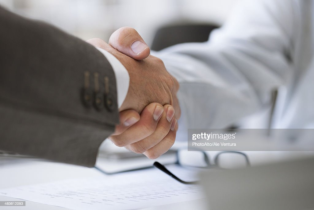 Business deal closed with handshake : Stock Photo