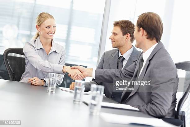 business deal - deal england stock photos and pictures