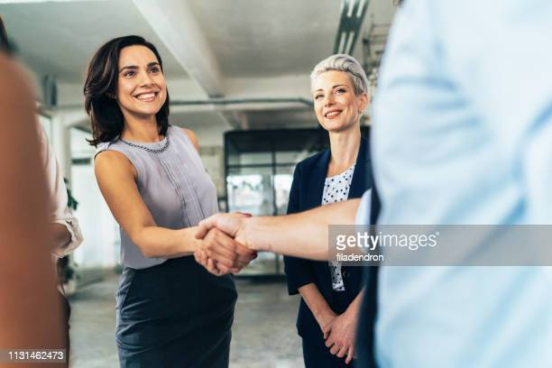 business deal with handshake - greeting stock pictures, royalty-free photos & images