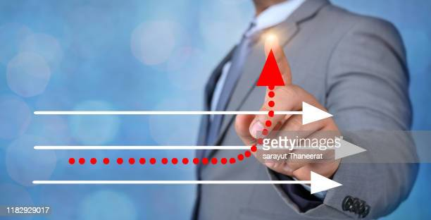business different direction the hand of a business man is pointing to a business change point - pbs stock pictures, royalty-free photos & images