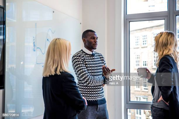 business discussion in the office - debate stock pictures, royalty-free photos & images