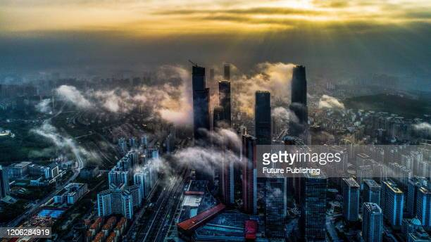 Business District in fog, Nanning, Guangxi, China, morning of march 8, 2020.- PHOTOGRAPH BY Costfoto / Barcroft Studios / Future Publishing