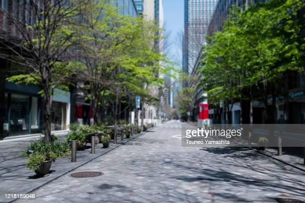 business district in tokyo marunouchi area - 丸の内 ストックフォトと画像