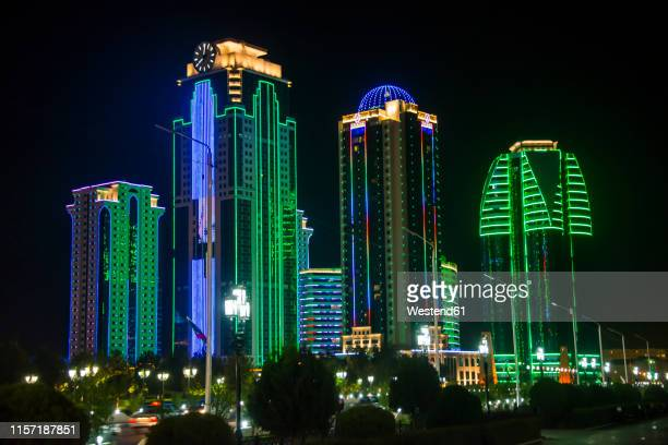 business district of grozny colourfulyl lluminated at night, grozny, chechnya - chechnya stock pictures, royalty-free photos & images