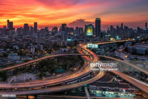 business district with expressway and highway at twilight, Bangkok, Thailand