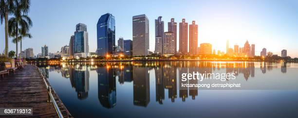 Business district with high building and Sun rise.