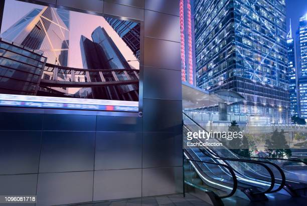 business district with large billboard display at dusk - visual china group stock pictures, royalty-free photos & images
