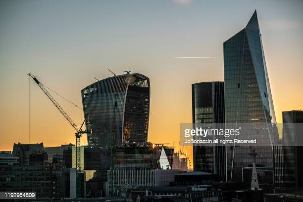 business districts - jcbonassin stock pictures, royalty-free photos & images