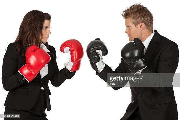 Business excutives fighting in boxing gloves