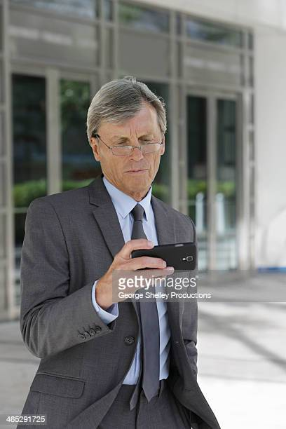 Business executive checking his smart phone