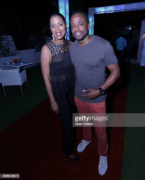 Business executive Debora Cumberbatch poses for pictures with American actor Dule Hill during the Estate 101 AllInclusive Carnival Fete as part of...