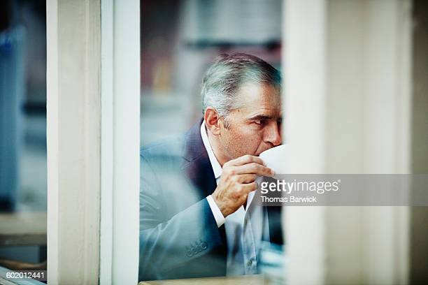 Business executive drinking coffee during meeting