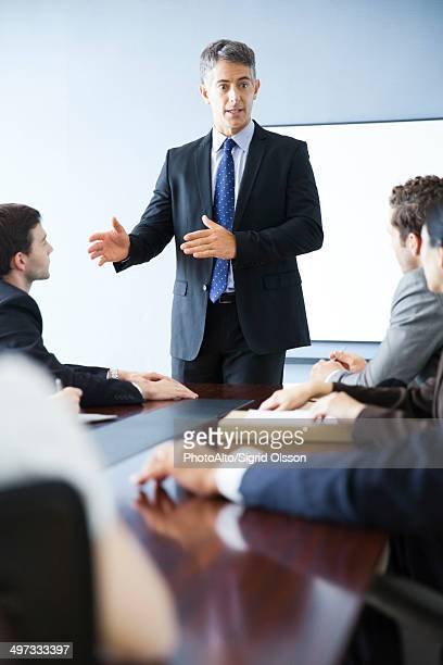 Business executive giving presentation at meeting