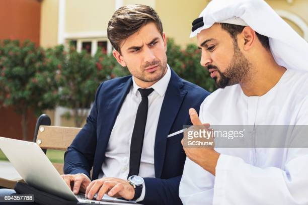 Business executive having a conversation with an Arabian businessman