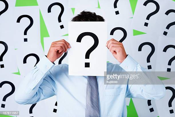 Business executive holding a sheet with question mark
