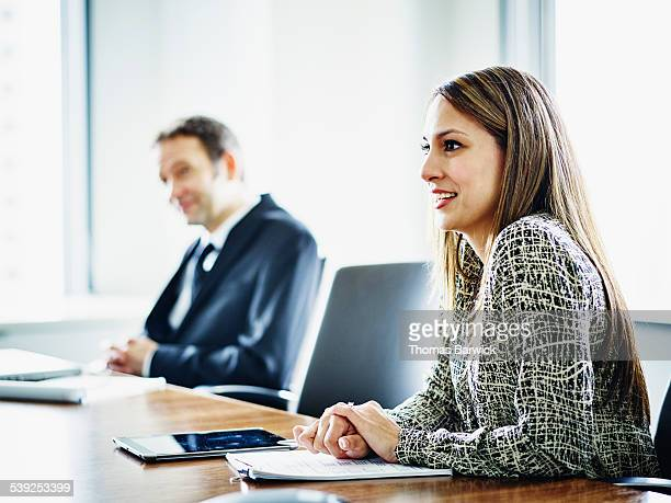 Business executive in discussion with colleagues
