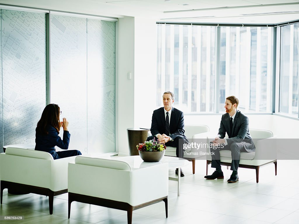 Business executive in discussion with colleagues : Stock Photo