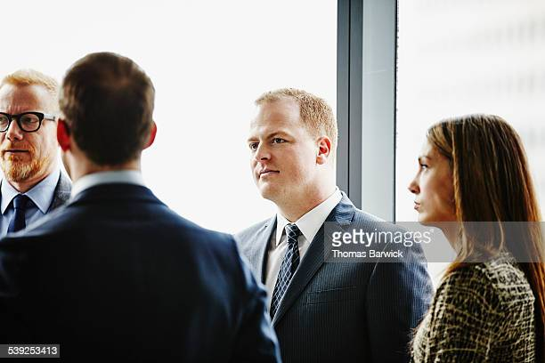 Business executive in informal office meeting