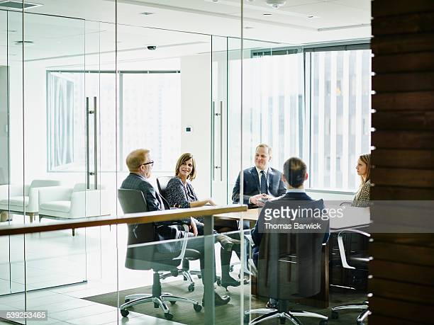 Business executive leading group meeting