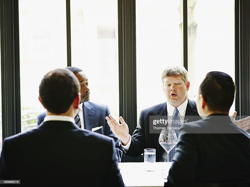 Business executive leading meeting in restaurant : Foto de stock