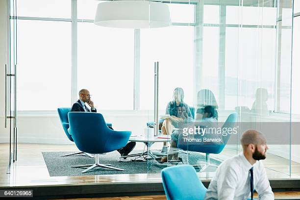 business executive listening during meeting - focus on background stock pictures, royalty-free photos & images