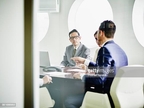 Business executive listening during team meeting