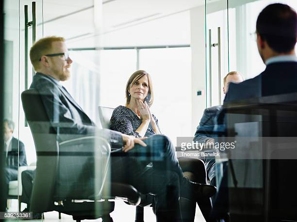 Business executive listening to presentation