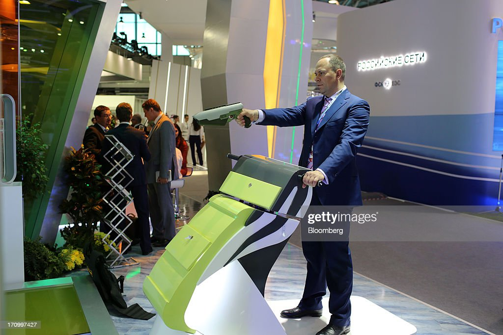 A business executive plays a computer game at the OAO Sberbank pavilion on the opening day of the St. Petersburg International Economic Forum 2013 (SPIEF) in St. Petersburg, Russia, on Thursday, June 20, 2013. Russian consumer spending probably eased and investment shrank at the fastest pace since 2011, adding to evidence the $2 trillion economy is stalling. Photographer: Andrey Rudakov/Bloomberg via Getty Images