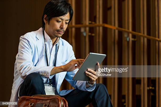 business executive reading email on his digital tablet - delegating stock photos and pictures