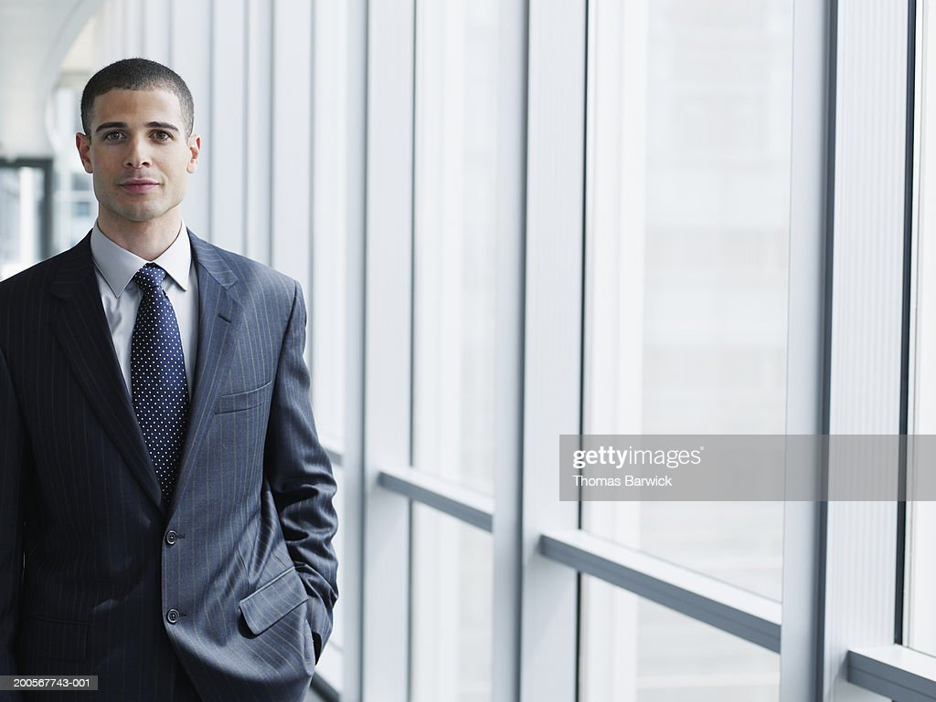 Business executive smiling, portrait : Stock Photo