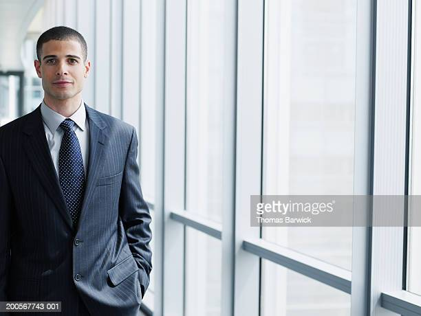 Business executive smiling, portrait