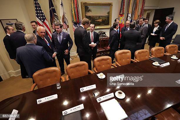 S business executives and members of the Trump Administration including Vice President Mike Pence wait for the arrival of President Donald Trump...