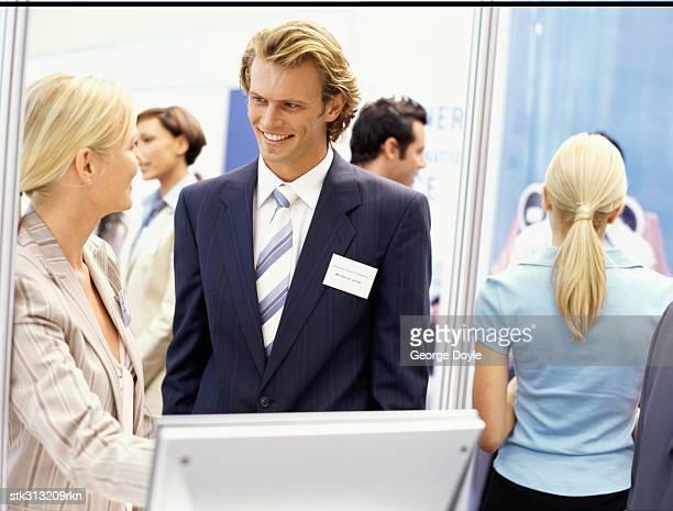business executives at an exhibition