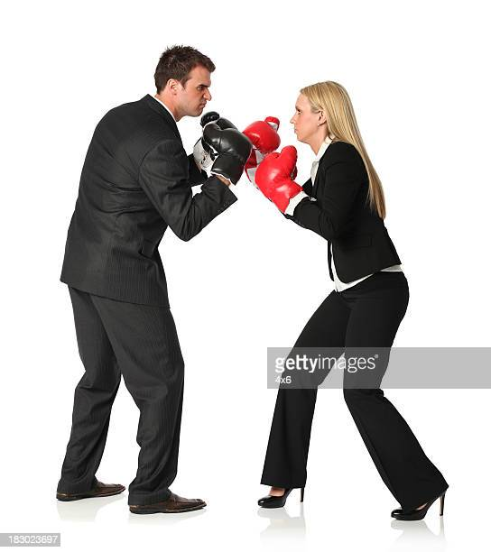 Business executives boxing