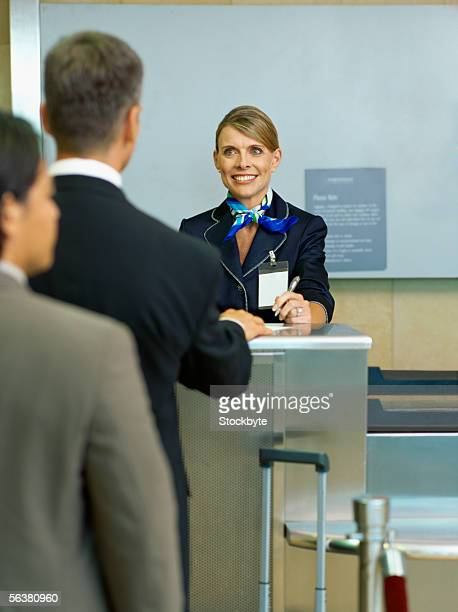 business executives checking in luggage at an airline ticket counter