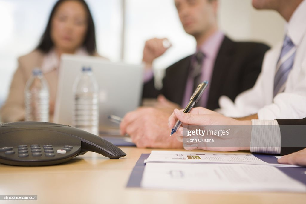 Business executives discussing at conference table (differential focus) : Foto stock