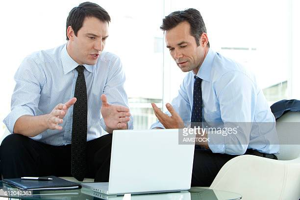business executives discussing business strategy - managing director stock photos and pictures