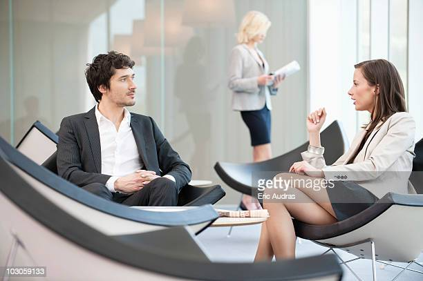 Business executives discussing in a waiting room