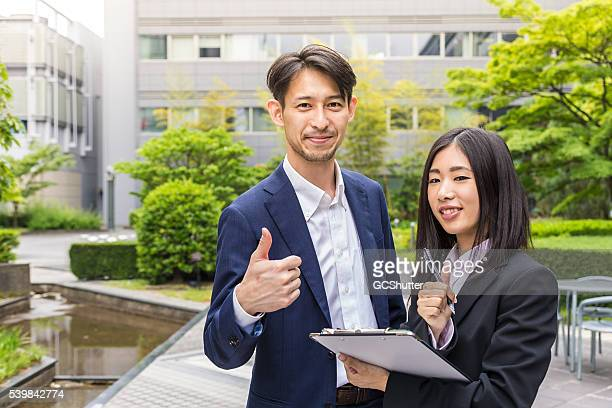 business executives gesturing thumbs up - coo bildbanksfoton och bilder