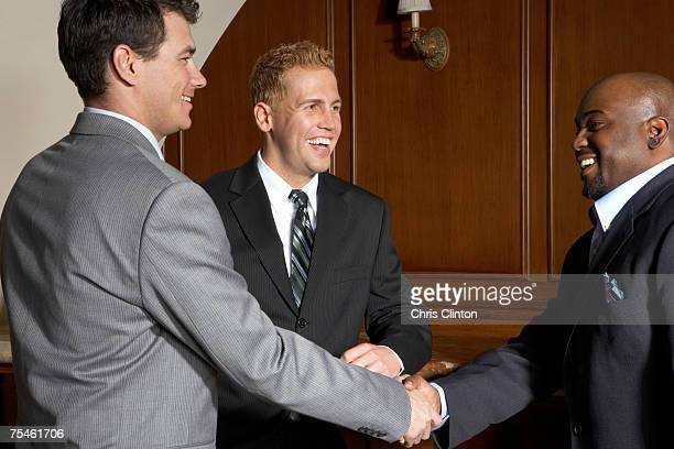 Business executives greeting at hotel reception