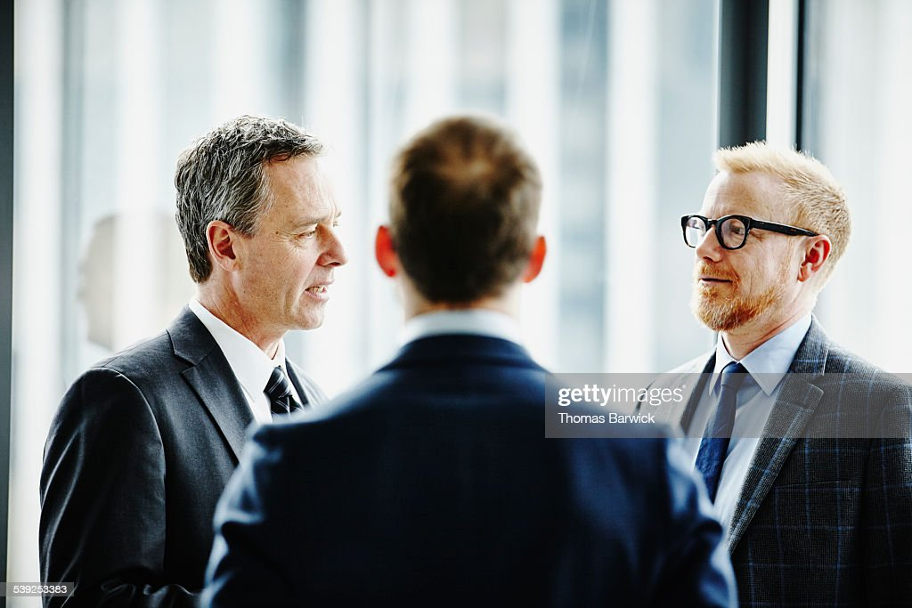 Business executives having informal meeting : Stock Photo
