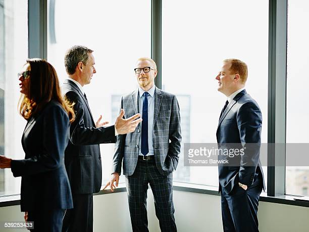 Business executives having informal office meeting