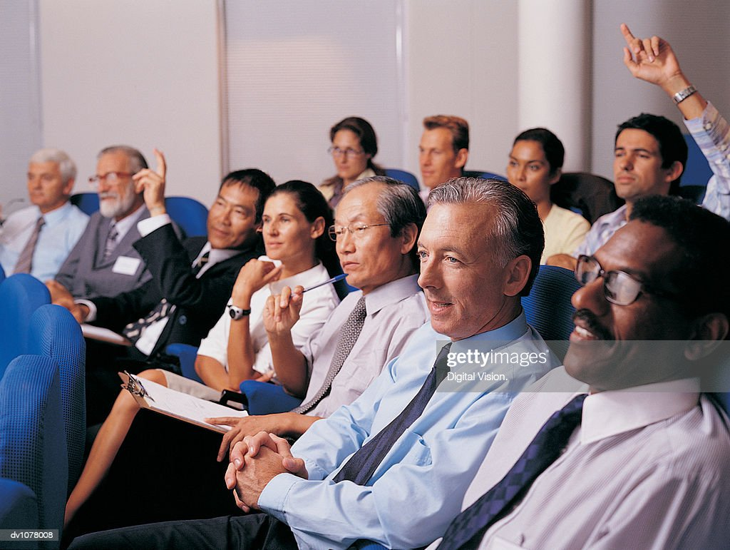 Business Executives in a Conference Room Asking Questions : Stock Photo
