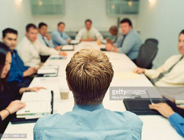 Business executives in conference, man in foreground