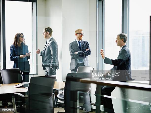 Business executives in discussion before meeting