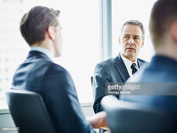 Business executives in discussion during meeting