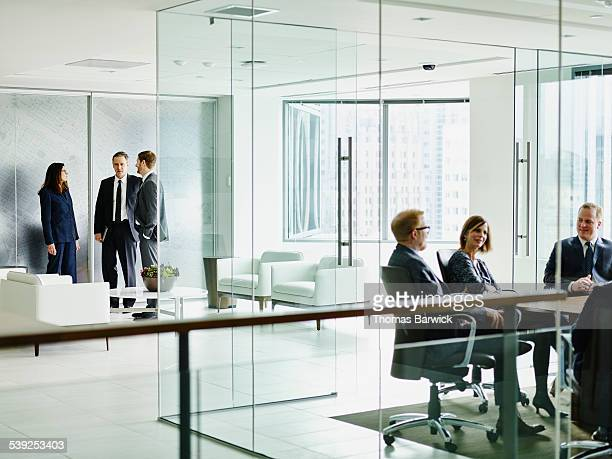 Business executives in discussion in office lobby